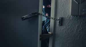 Dangerous,Masked,Burglar,With,Crowbar,Breaking,Into,A,Victim's,Home